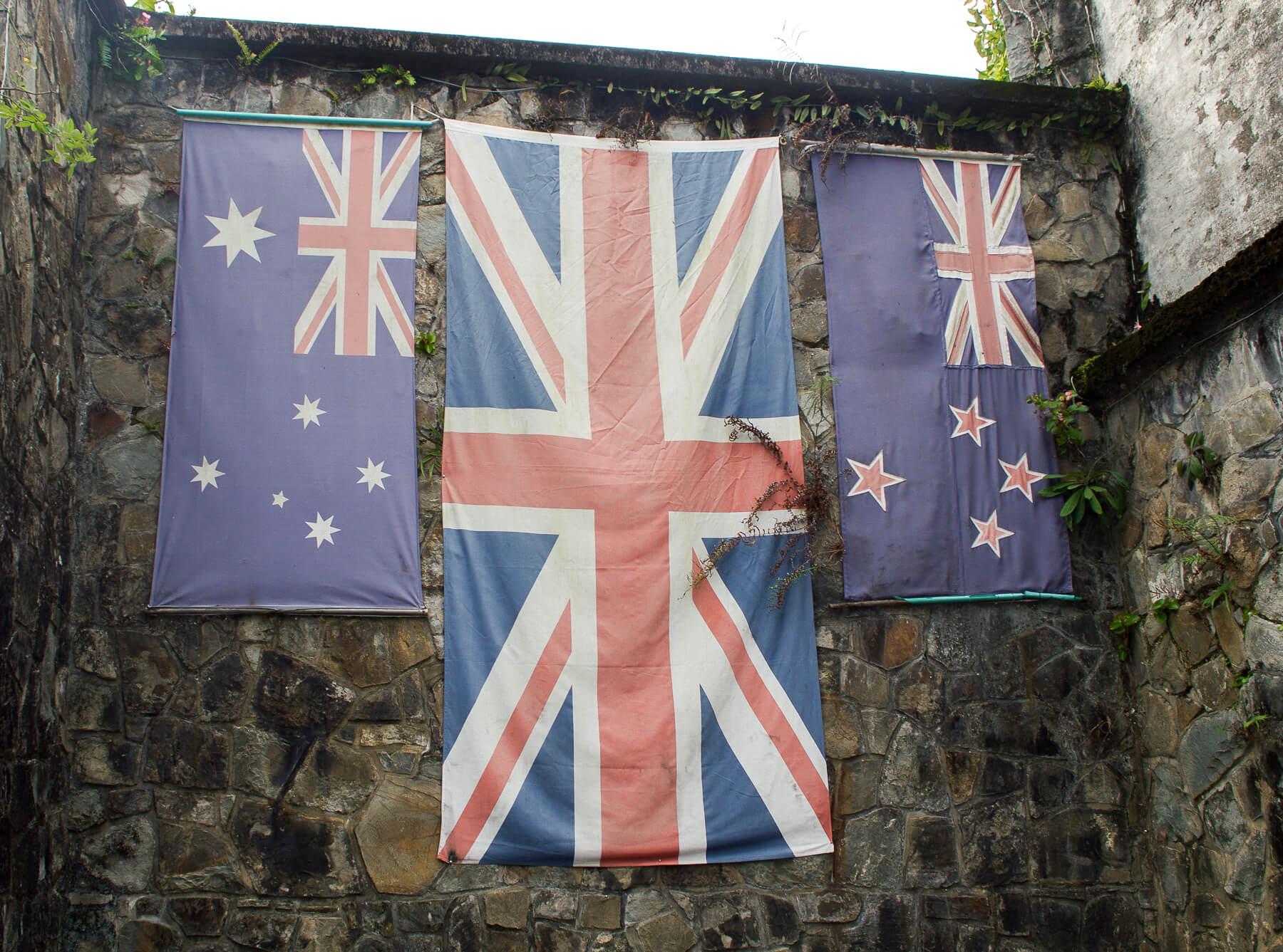 Australian, UK and NZ flags at war memorial in Borneo