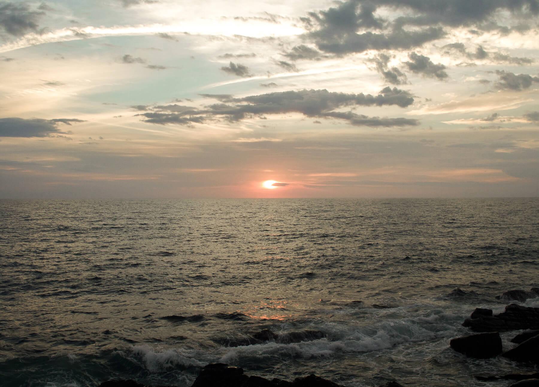 Sun setting behind the ocean in Borneo