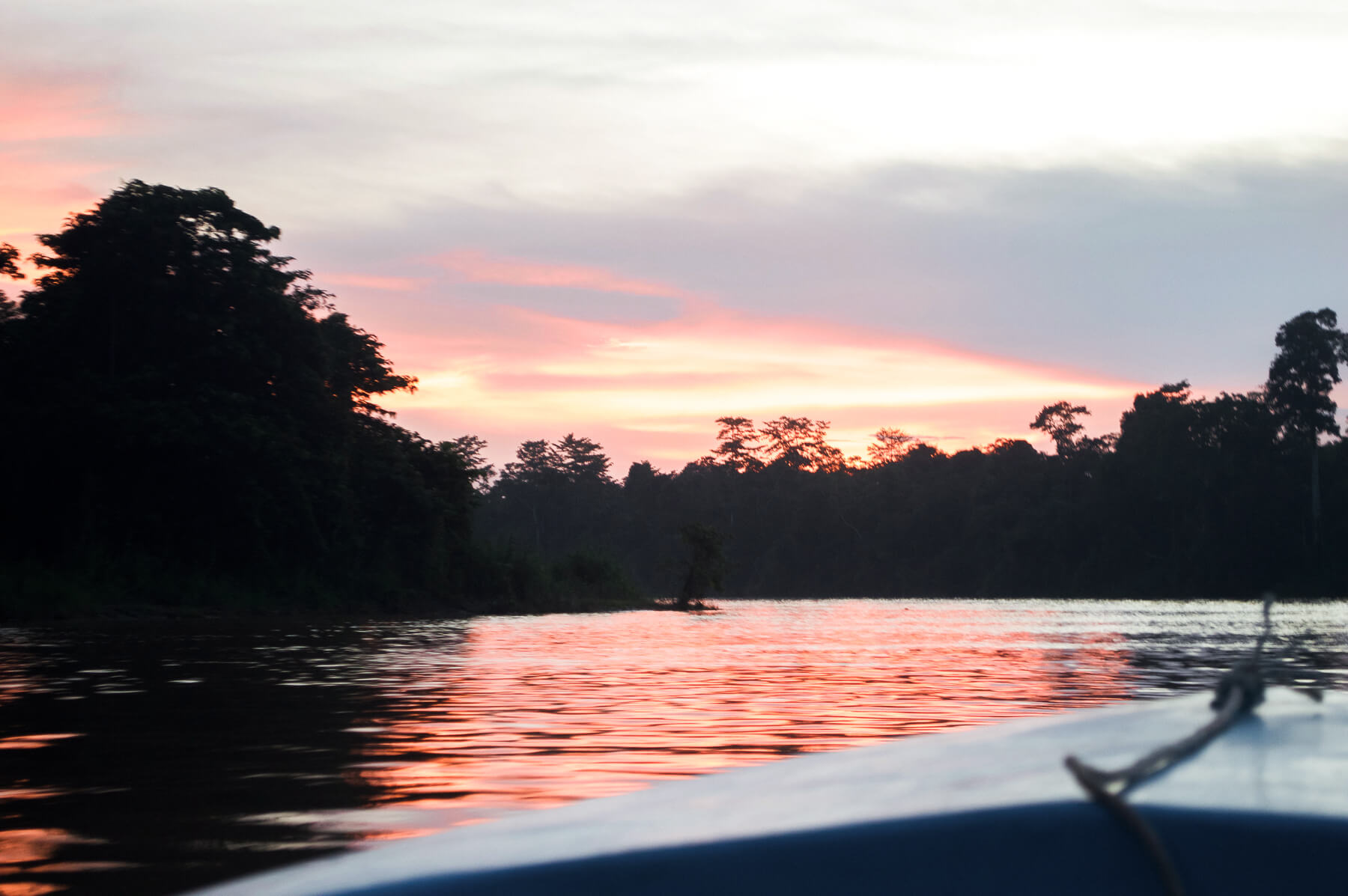 View of sunset from boat on Kinabatangan River