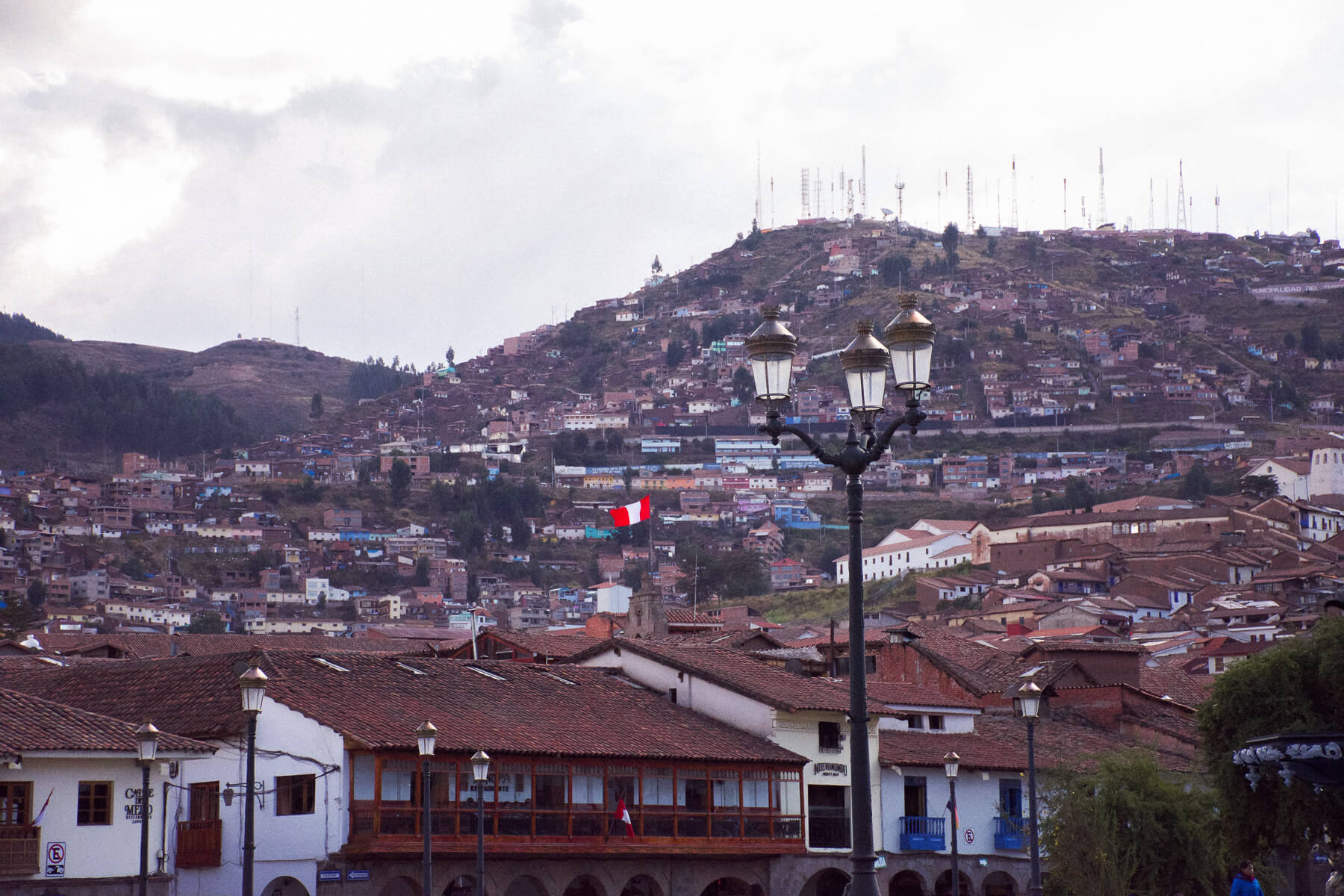 Overlooking the hills behind Cusco, filled with houses and ruins