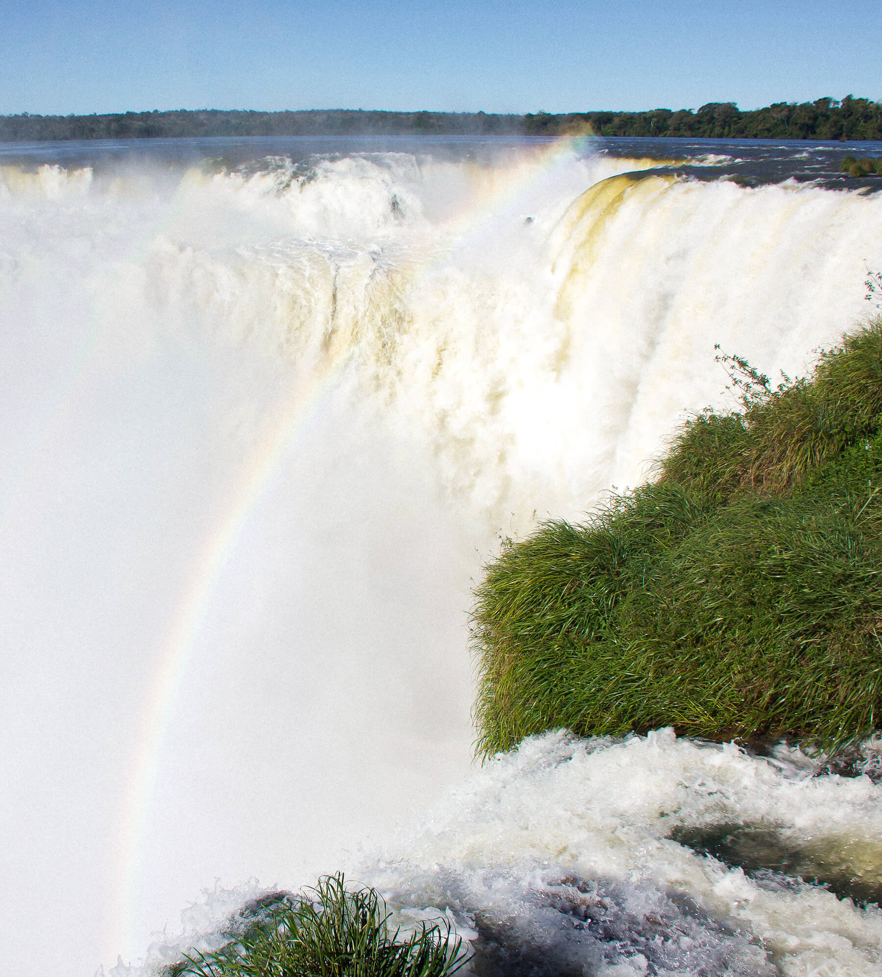 The biggest waterfall in Iguazu National Park, water streaming into a canyon with a waterfall shining above