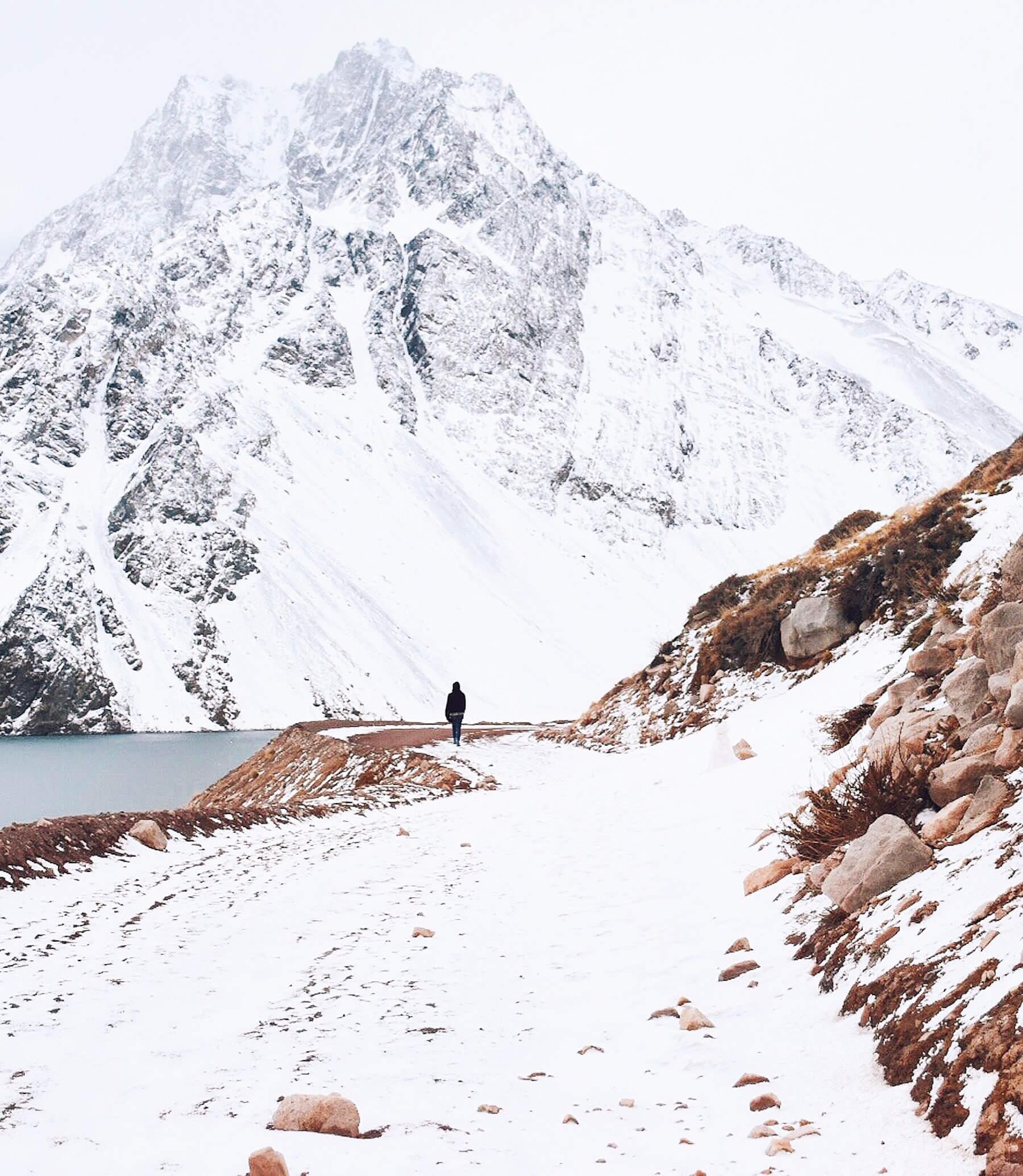 Girl walking through snow during a trip to Cajon Del Maipo