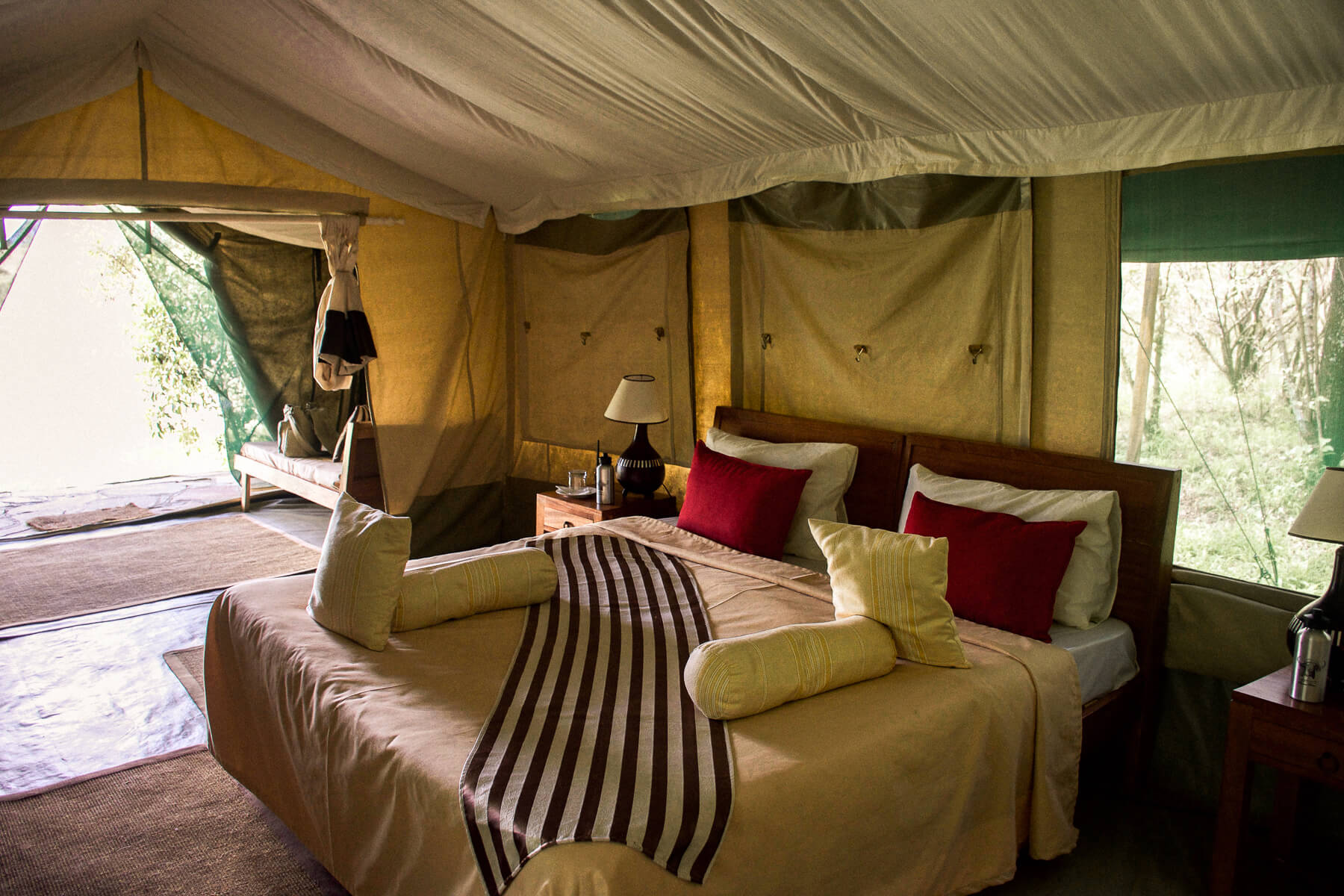 The inside of Losokwan Luxury Tented Camp at a big queen bed