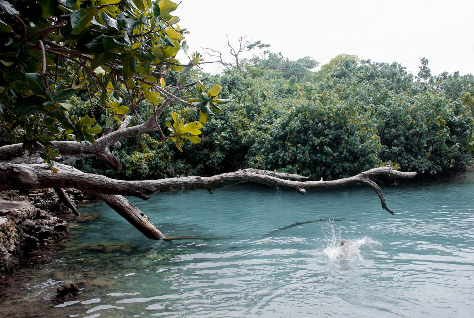 Someone jumping into Blue Lagoon Vanuatu
