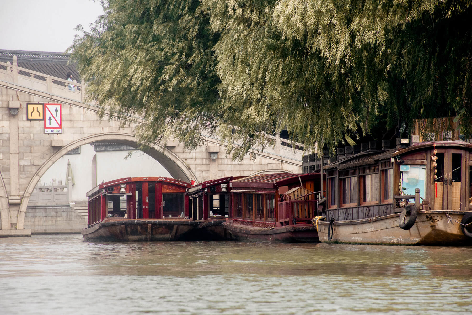 Old Chinese boats lined up on the bank of the Grand Canal in Suzhou