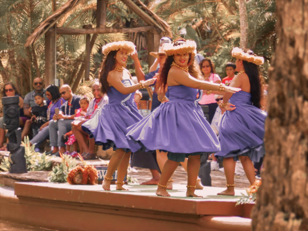 4 Hawaiian Hula dancers dancing on a stage