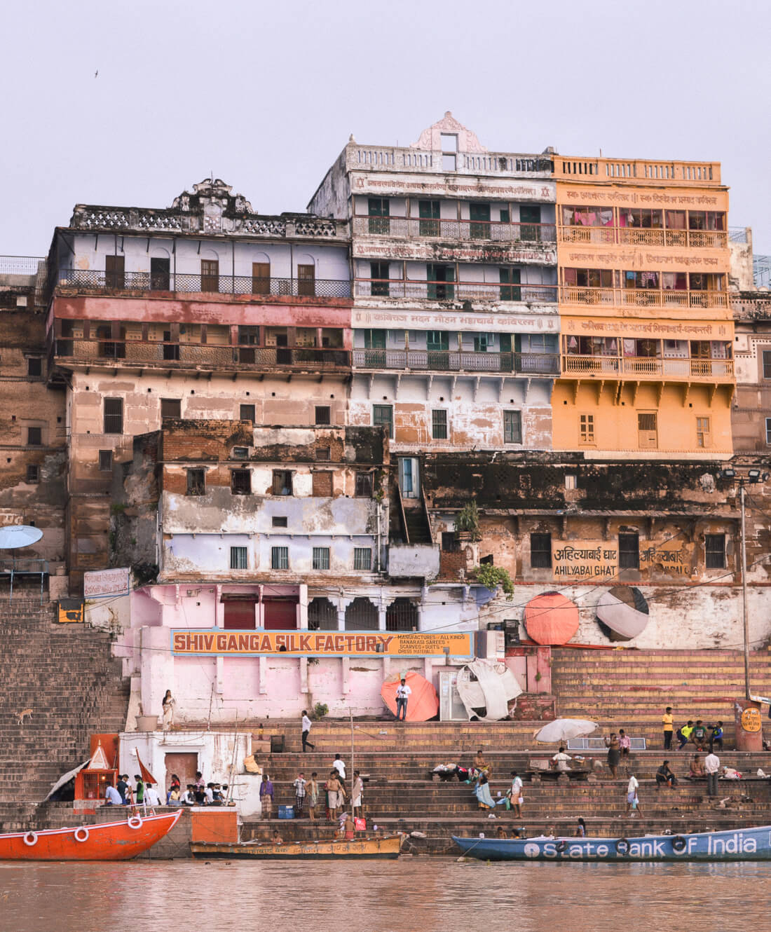 Colourful buildings and boats on the banks of the Ganges River in Varanasi