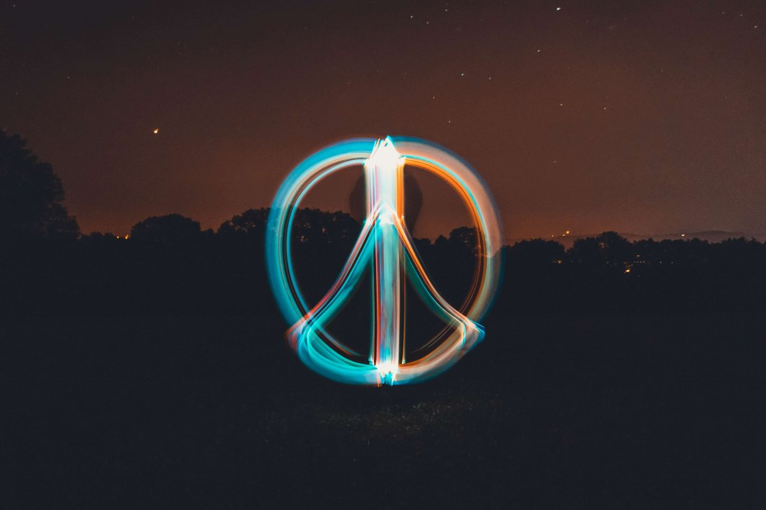 Colourful peace sign taken in slow shutter photography