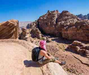 Sitting on the top of the Monastery in Petra, Jordan.