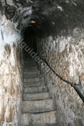 Narrow staircase carved in stone at Bran Castle