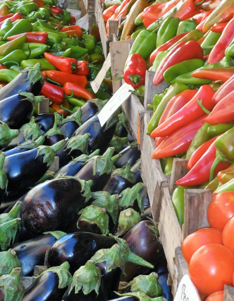 peppers and aubergines on sale in bulk