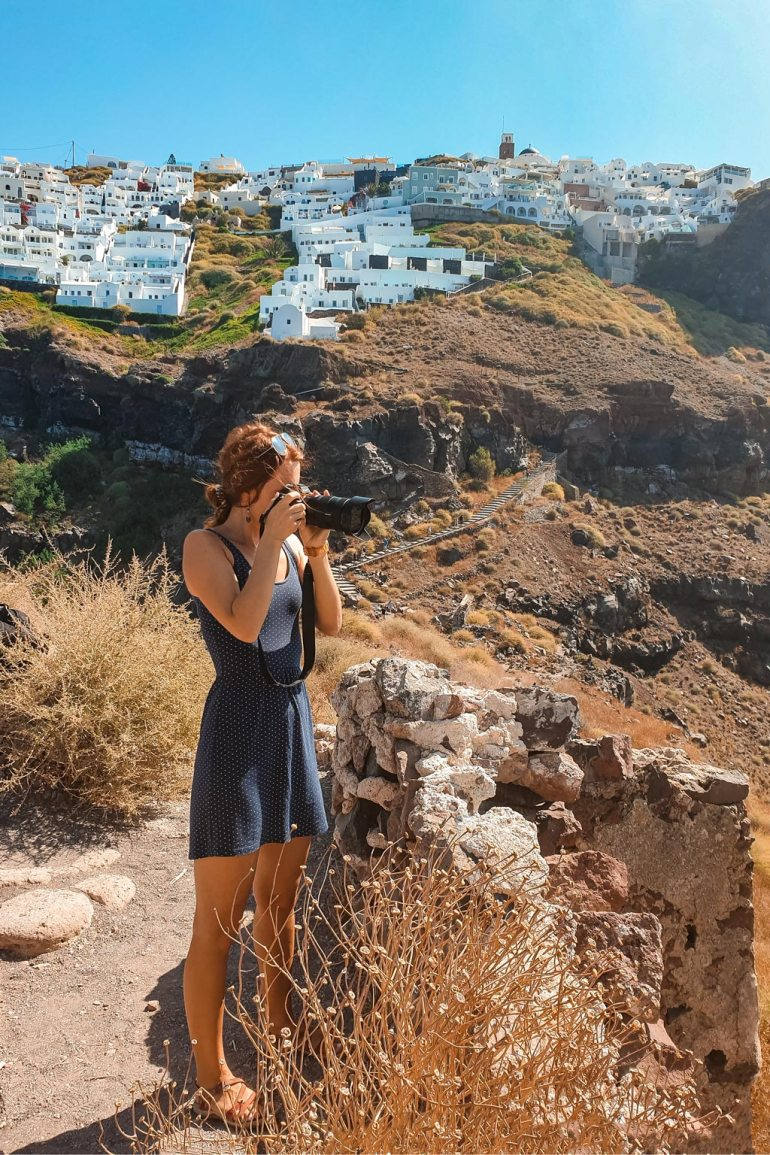 Julia Taking Photos in Best Photography Spots in Santorini