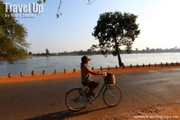 biking angkor archealogical park cambodia lake