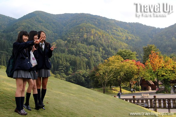 05. shirakawago village japan schoolgirls near entrance