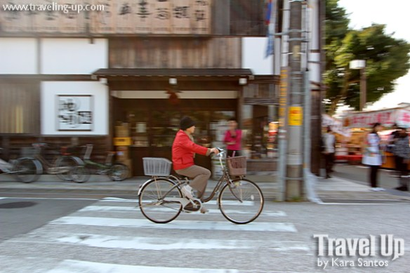 takayama autumn festival japan woman biking