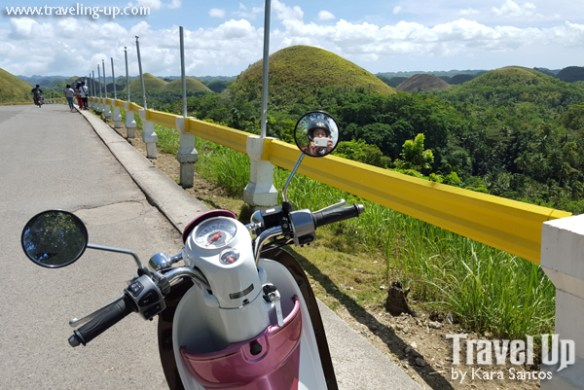 bohol by motorcycle scooter chocolate hills mirror selfie