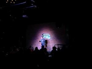 Kermit Apio on stage at the Spokane Comedy Club.