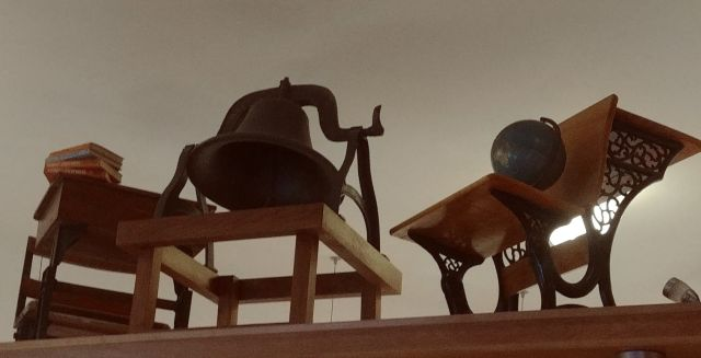 School Grounds Coffee House and David A Morrow Gallery school desks and bell