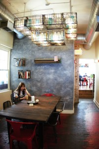 a woman sitting inside PS and Co cafe in Philadelphia