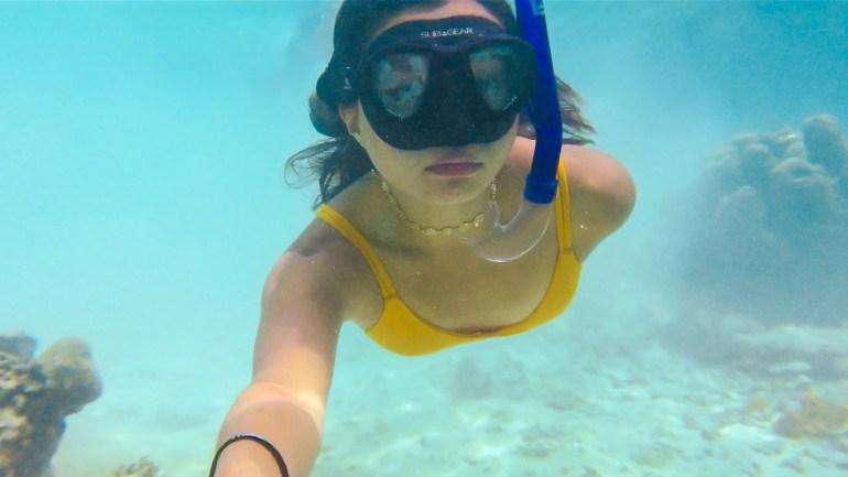 Underwater Swimming at Coron | Amazing Travel Photography Gear | TravelingPetiteGirl.com