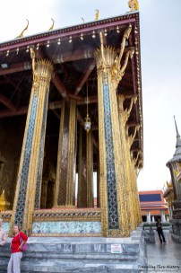 This is how tall the lowest section of the Temple of the Emerald Buddha is. The streaks in the picture are from the rain that was coming down.