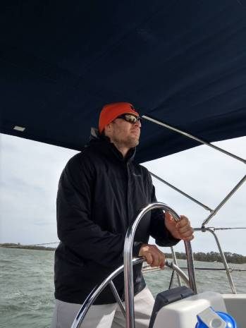 At the wheel with Windward Sailing
