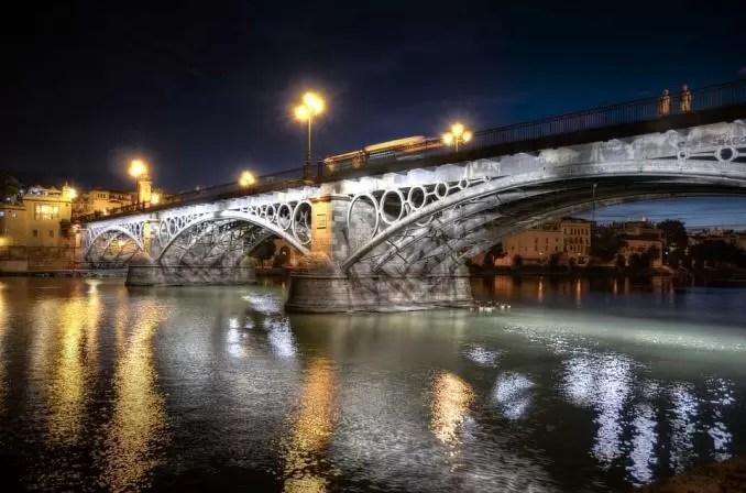 Triana Bridge Seville Spain e1554444068140 - Seville Tourist Guide   Best Places To Visit in Seville, Spain