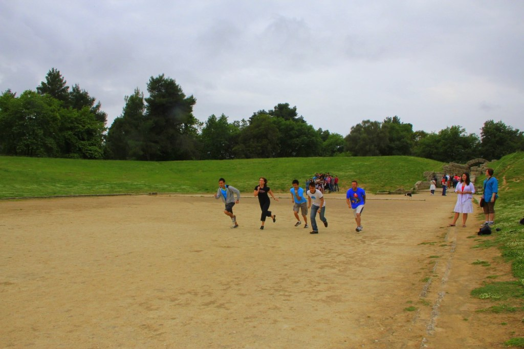 Running at the FIRST Olympic Stadium at Olympia, Greece