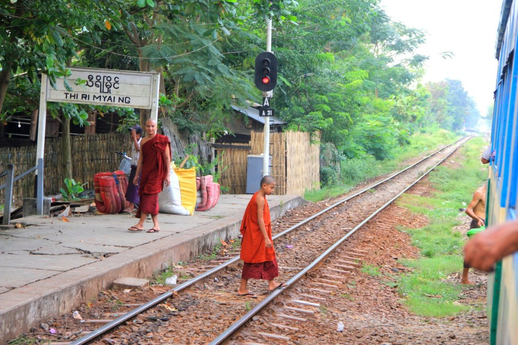 Monk at crossing the Burmese railway track