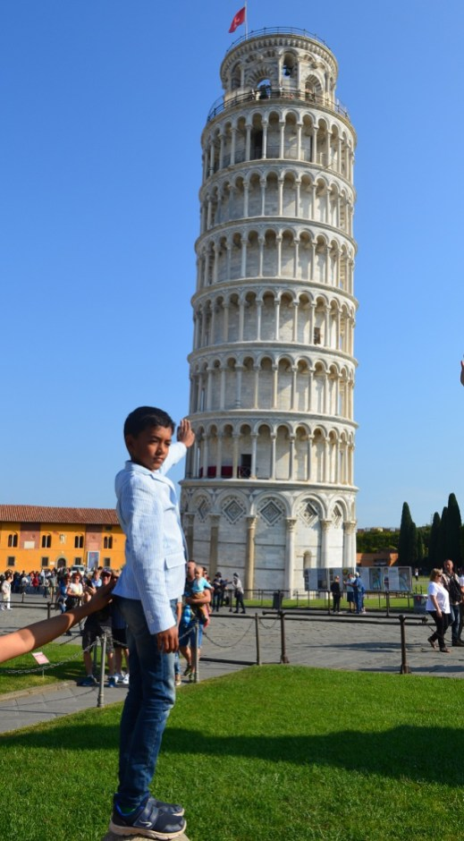 Against the leaning tower of Pisa
