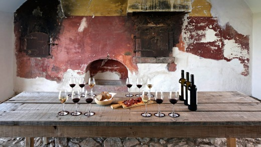 Wine tasting by the old wood-fired oven at Sao Lourenco do Barrocal.