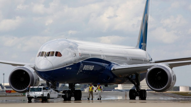 Boeing employees walk the new Boeing 787-10 Dreamliner down towards the delivery ramp area at the company's facility in ...
