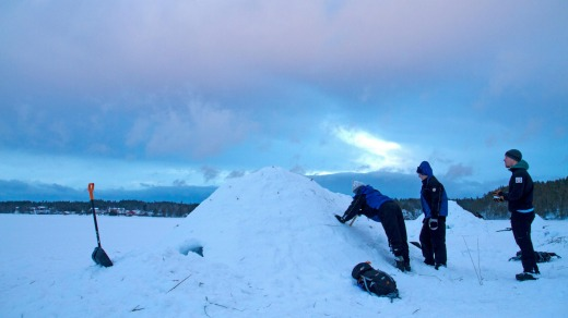 Building a quinzee (snow igloo) in Oulanka National Park.