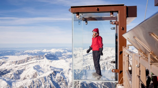 'Step into the Void' glass box on the Aiguille Du Midi mountain top above Chamonix Mont-Blanc.