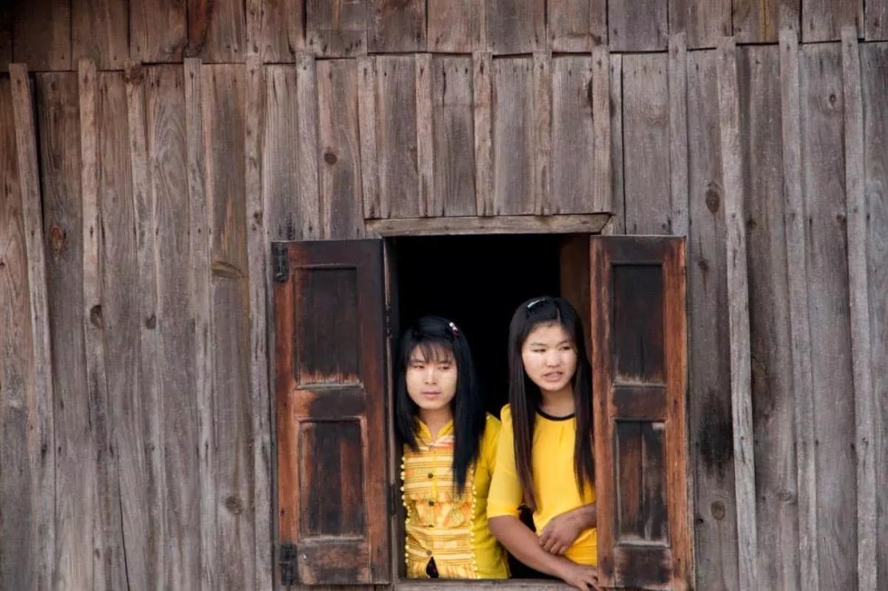 Young girls watching their brothers getting ready for Novitiation ceremony, Myanmar