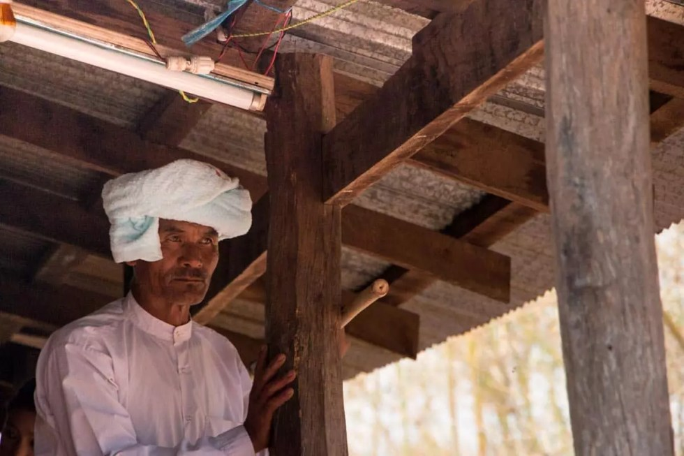 Father in home in village of ceremony, Myanmar