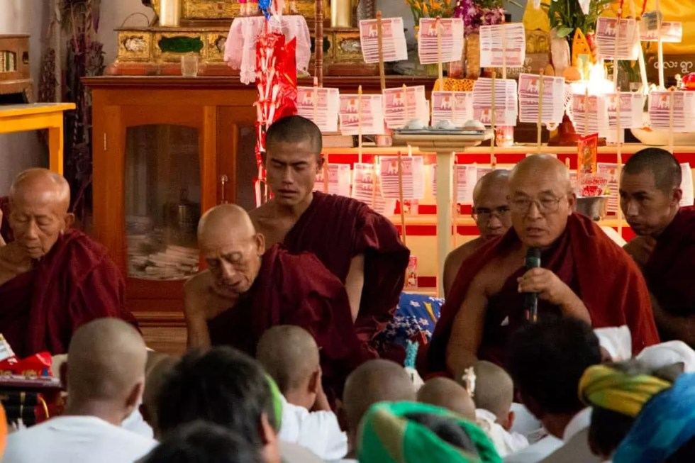 Elder monks performing ceremony at temple