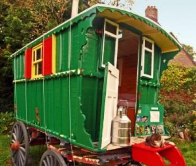 A Bright green traditional gypsy caravan