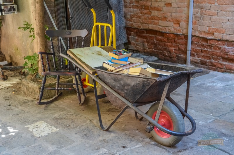 Libreria Acqua Alta Bookshop in Venice Italy has a whole array of unusual bookshelves to look through including this wheelbarrow. If you notice, they have also positioned a rocking chair carefully nearby just in case you fancy sitting down to read on of your new finds.