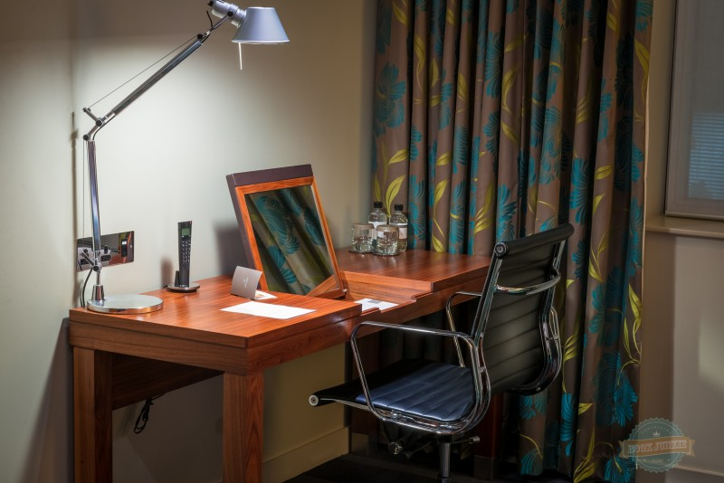 Desk area in the room at the apex london wall hotel