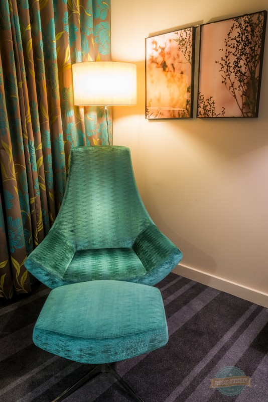 Chair in a bedroom at the Apex London Wall