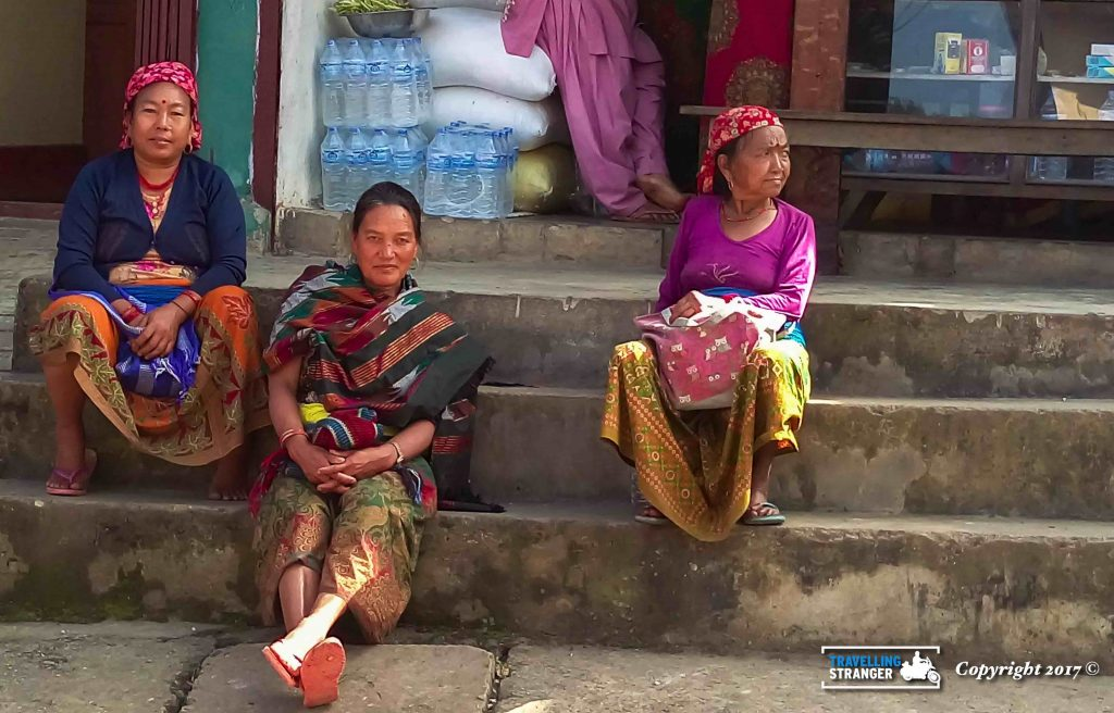 Ladies in Nepal relaxing in the shade.