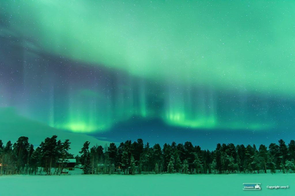 The Northern Lights on Lake Inari , Finland