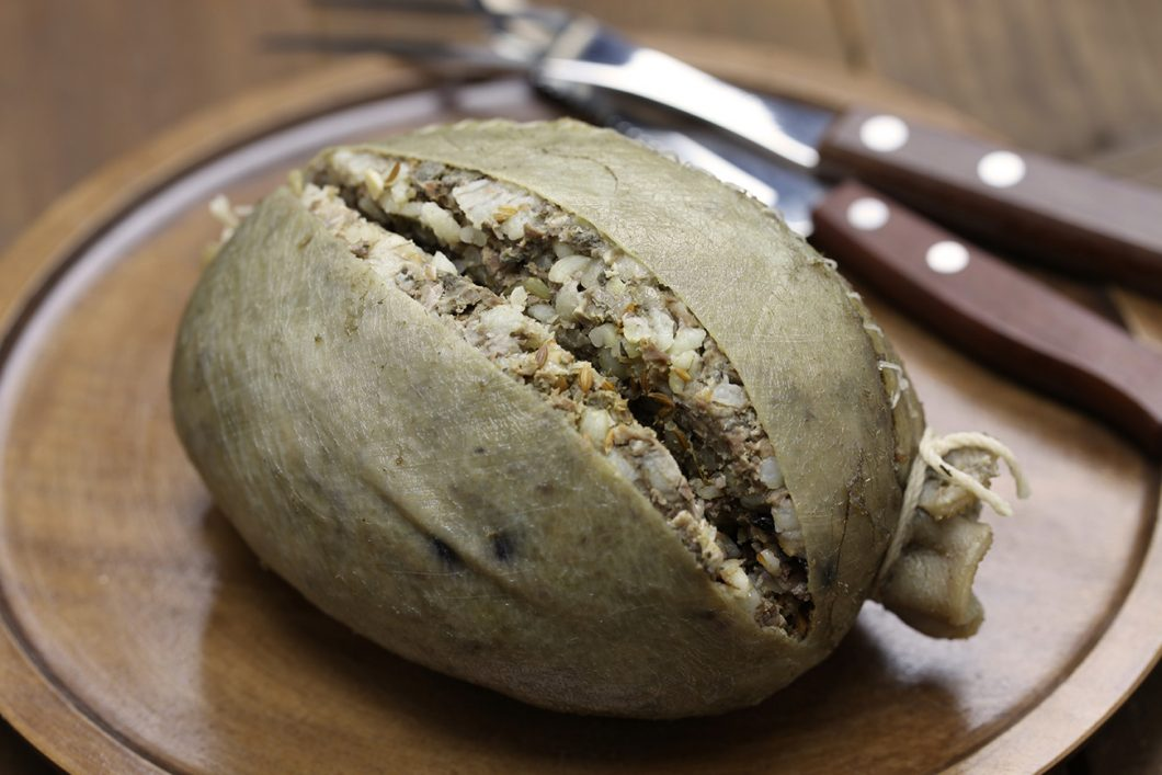 Haggis - sheep stomach filled with minced animal`s organs and its head, Scotland