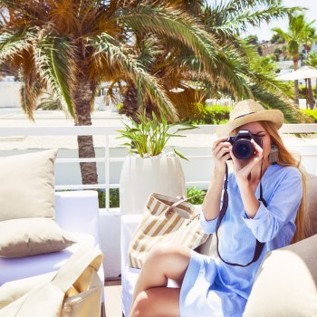 Woman taking photo at hotel