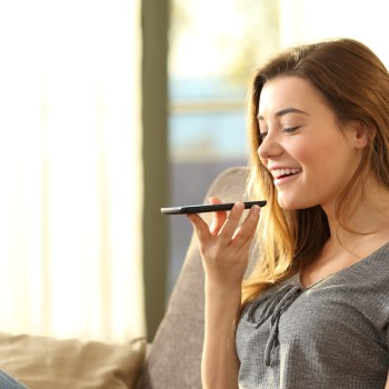 Woman using voice search on smartphone