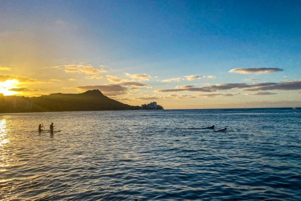 Surfers at sunrise over Diamond Head