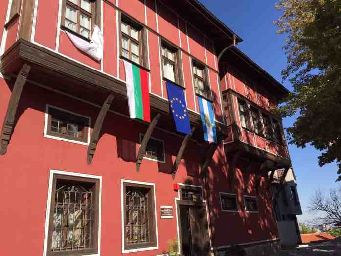 Red European building with European flag and Bulgarian flag