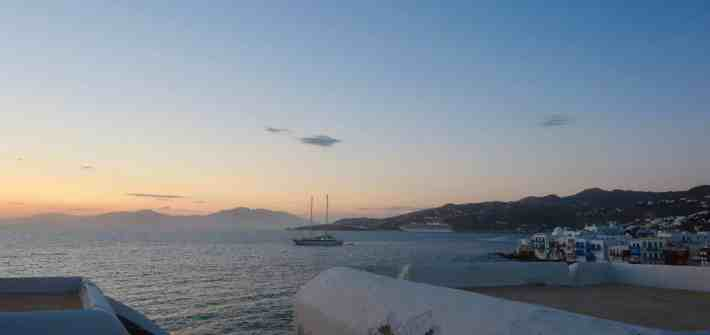 blue sea at sunset with white houses in Greek Island