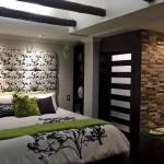 Master bedroom exposed beams Cuenca Rental
